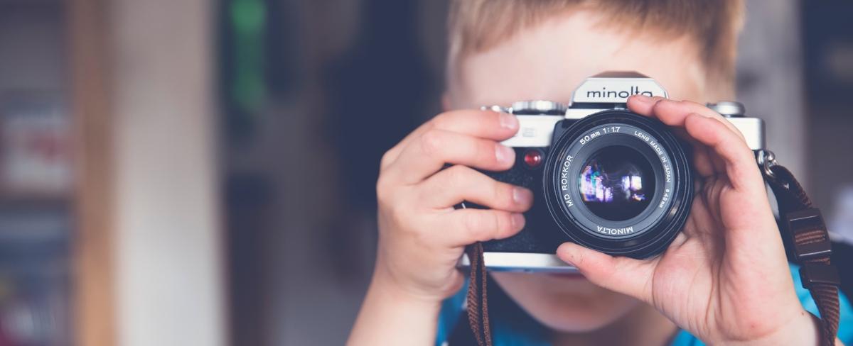 nen amb canara de fotos